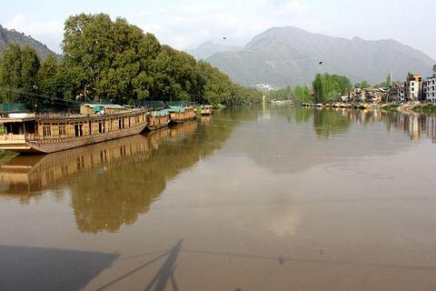 Two school boys feared dead after slipping into Jhelum