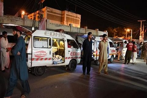 Families stage sit-in as death toll in Pakistan bus attack rises to 22