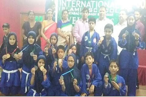 Int'l Islamic school felicitates medalists