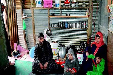 Shopian family spends sub-zero nights under tin shed