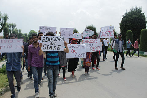 Students protest fee hike by Kashmir University