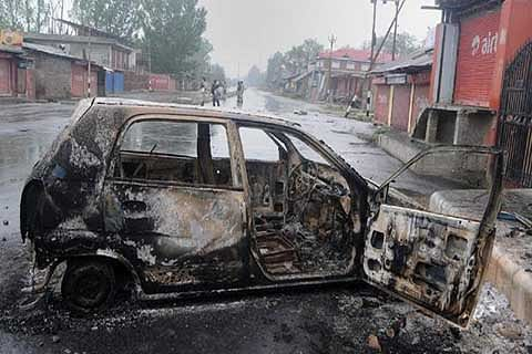 Protesters torch cop's vehicle