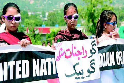Children with mock wounds stage demo in PaK against use of pellet guns in Kashmir