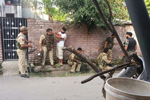 Seven suspected militants, policeman killed in Kashmir gunfights