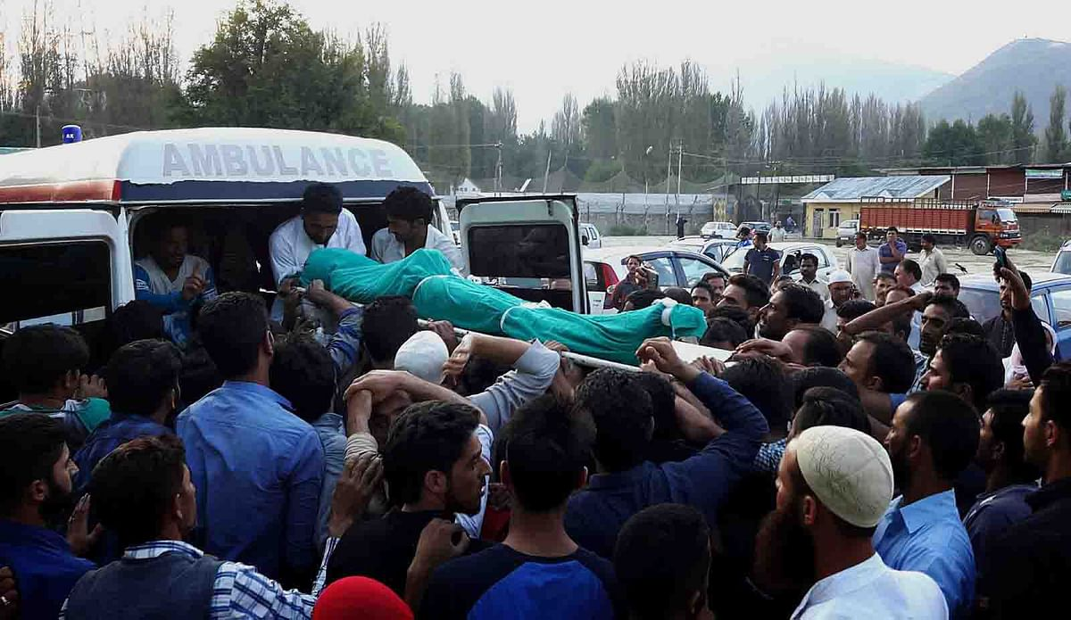 Eyes moist, hearts numb as Baramulla youth laid to rest