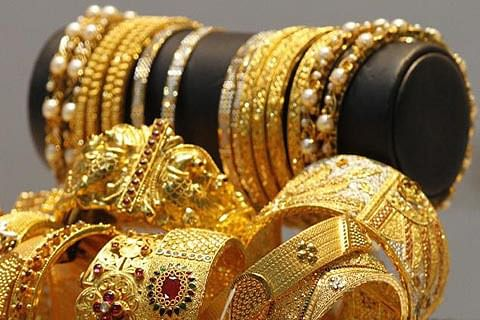Gold perks up as global cues stay positive