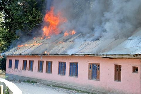 BURNING OF SCHOOLS IN KASHMIR: Govt condemns, says committed to peace with dignity