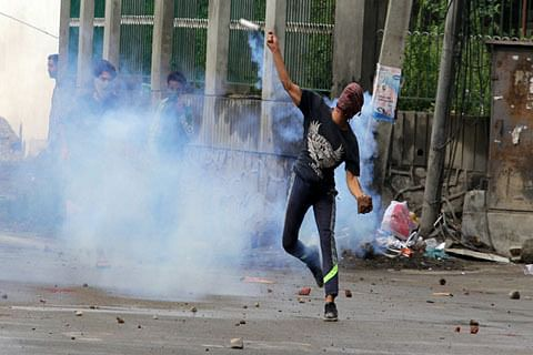 Youth hit by teargas shell during clashes in Anchaar Soura