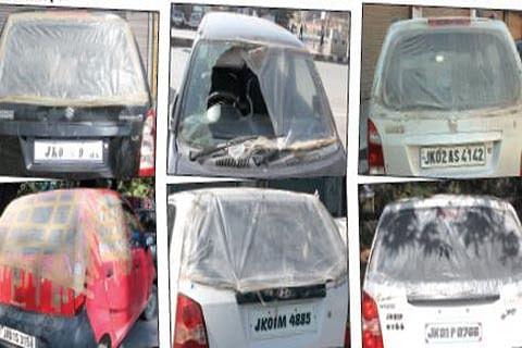 In strike-ridden Kashmir, replacing damaged car windowpanes daunting task