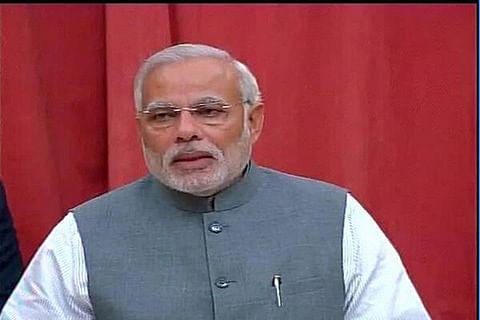 In emotional speech, Modi defends currency spike