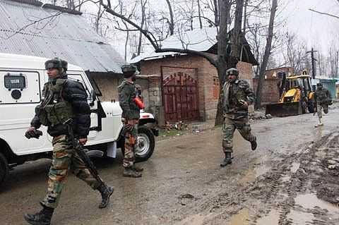 Militants give slip to forces amid firing, protests