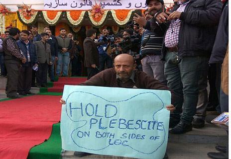 Legislator Rashid stages protest outside assembly, demands plebiscite