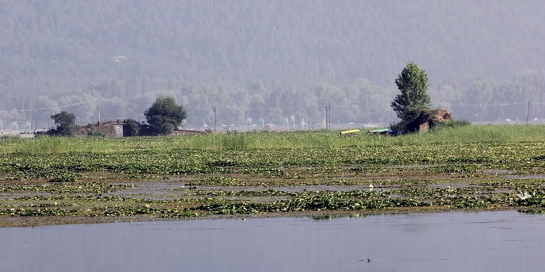 Authorities sit on dumping of construction material around Dal lake