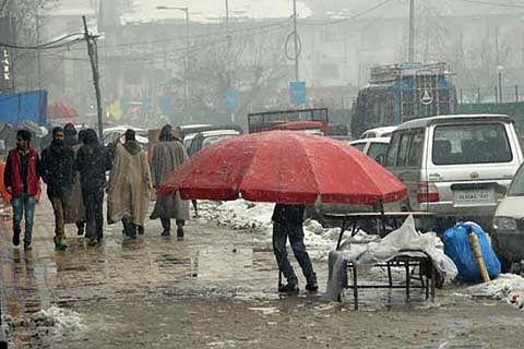 Fresh snowfall disrupts life