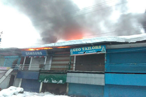 Fire damages three shops in Baramulla