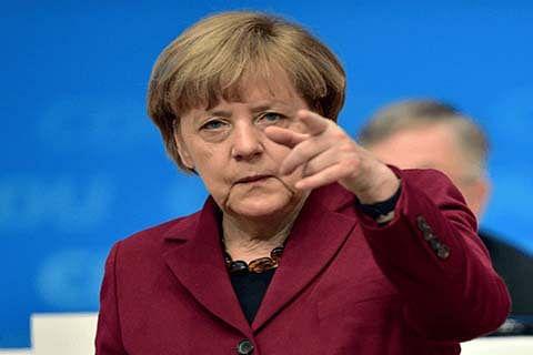 Merkel slams Trump travel ban