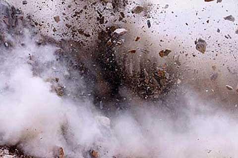 Two killed as bomb hits Afghan military base
