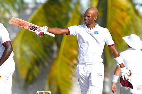 Ton-up Chase, Holder give West Indies edge