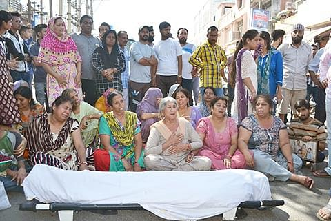 Family members of accident victim hold protest, demand compensation