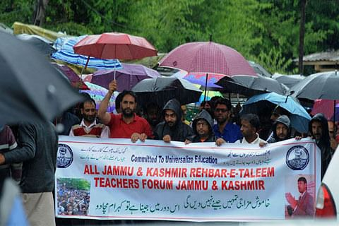 Video  ReTs hold protest in Kashmir capital against delay in releasing salaries