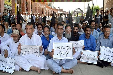 Traders protest frequent restrictions in Downtown