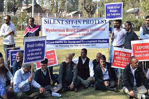 Civil society holds sit-in against braid chopping