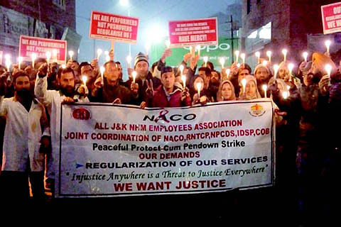 On day-7 of protest, NHM employees hold candle light march