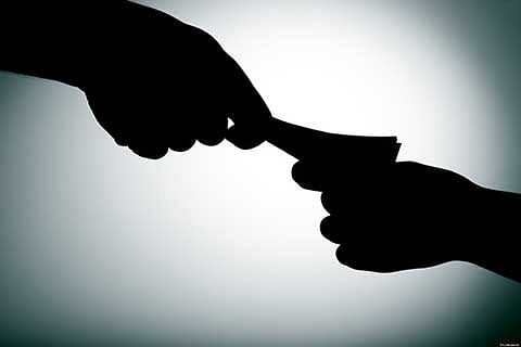 DTI attached after TV channel shows cop taking bribe from truck operators