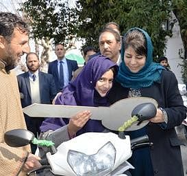 Chief Minister hands over motorized bicycles among specially abled youth