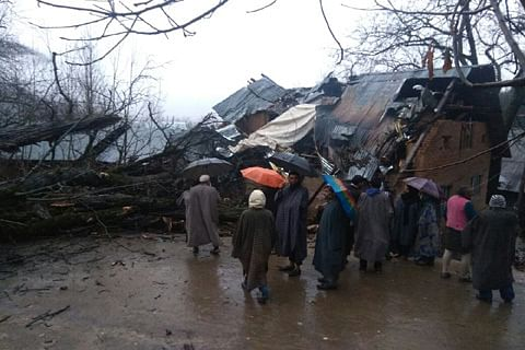 Miraculous escape for Kupwara family after tree falls on house