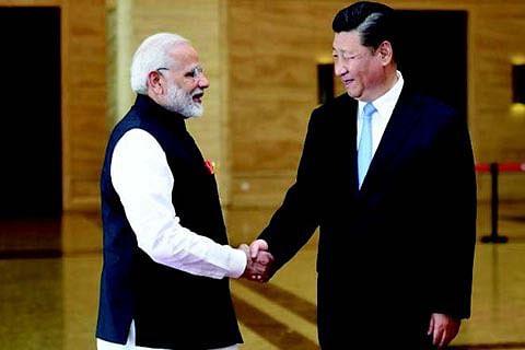 "Modi, Xi hold informal summit to 'solidify"" relationship"