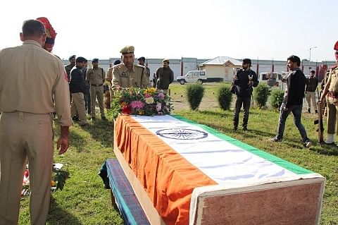 Floral tributes paid to policeman killed by militants in Kulgam