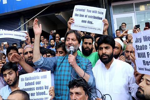 Yasin Malik leads JRL protest in Srinagar against assault on Article 35-A