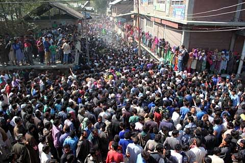 Thousands attend funeral of Langate militant after exhumation