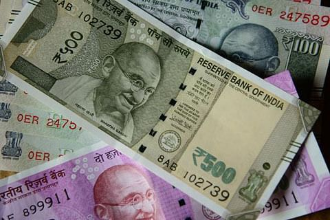 Rupee breaches 72 per US dollar mark for first time