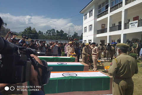 Floral tribute paid to three policemen killed after abduction in south Kashmir's Shopian