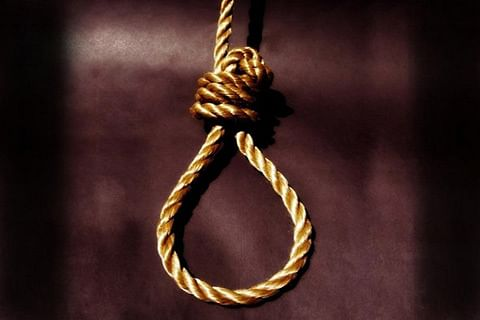 Man found hanging from ceiling
