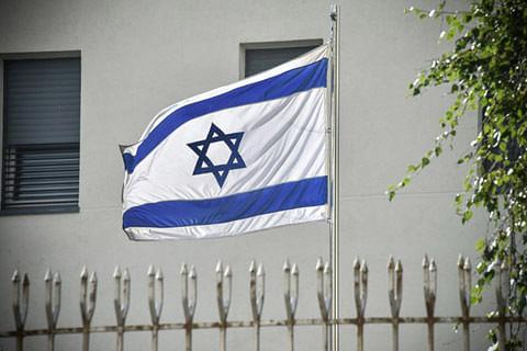 Israel protests after Jordan minister pictured stepping on flag