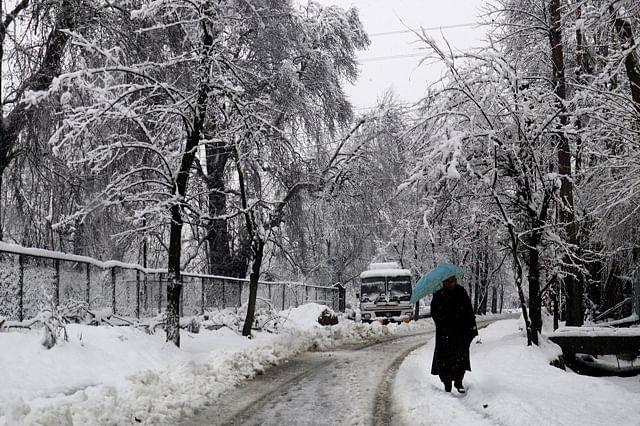 View of snow-covered Srinagar-Baramulla highway