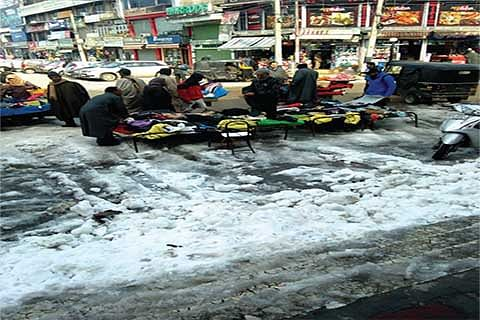 3 days on, city centre reels under snow mounds, water-logged roads