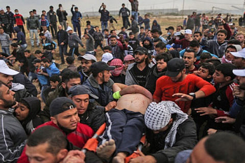 Palestinian dies of wounds after Israel border fire: Gaza ministry