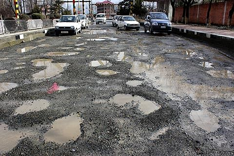 Back-breaking roads cry for attention