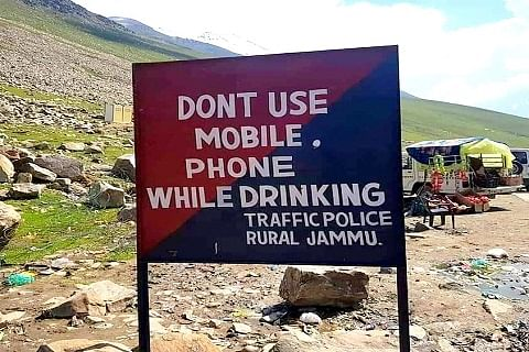 Inquiry ordered after signboard with 'don't use mobile phone while drinking' message installed on Mughal Road