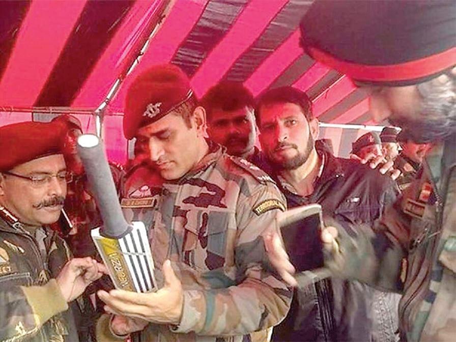 Image of Dhoni signing bat in south Kashmir goes viral