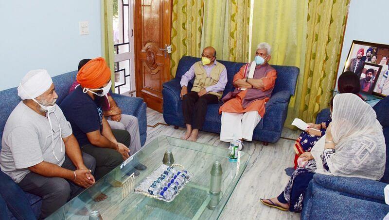 LG visits family of slain BDC chairman in Jammu