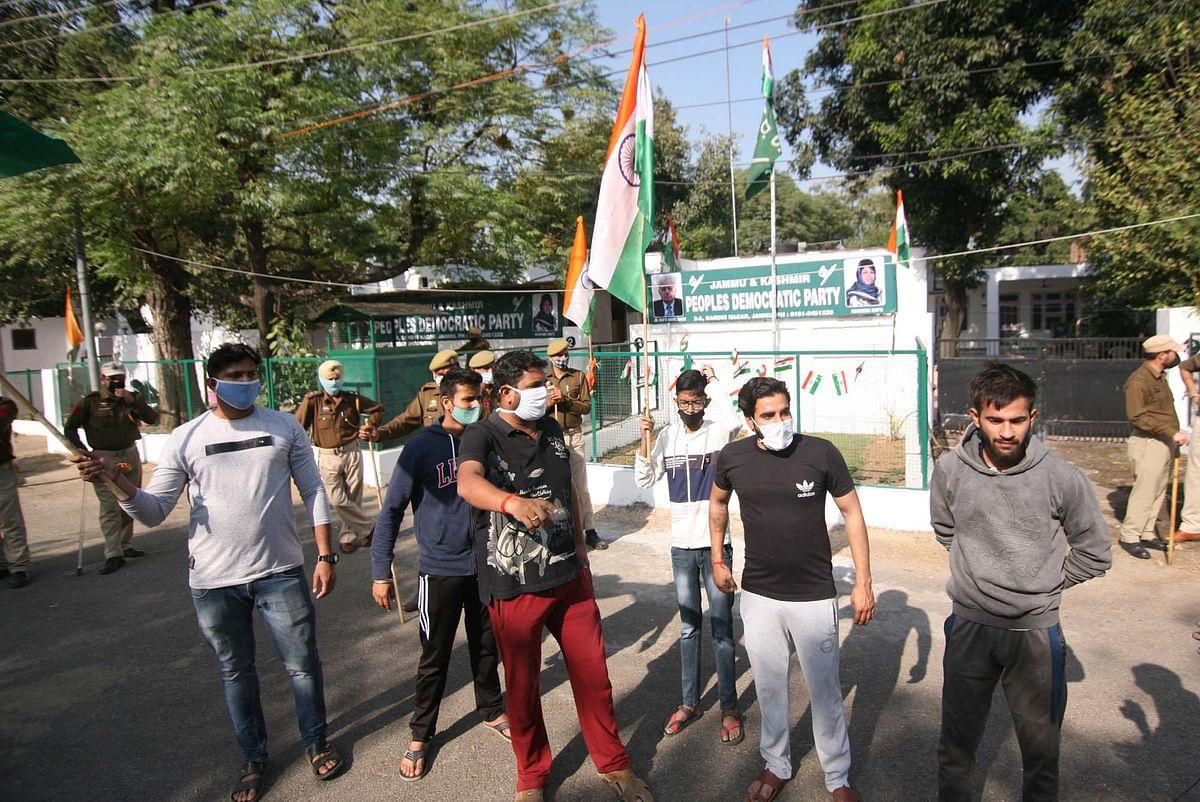 Erstwhile J&K state flag burnt outside PDP office in Jammu