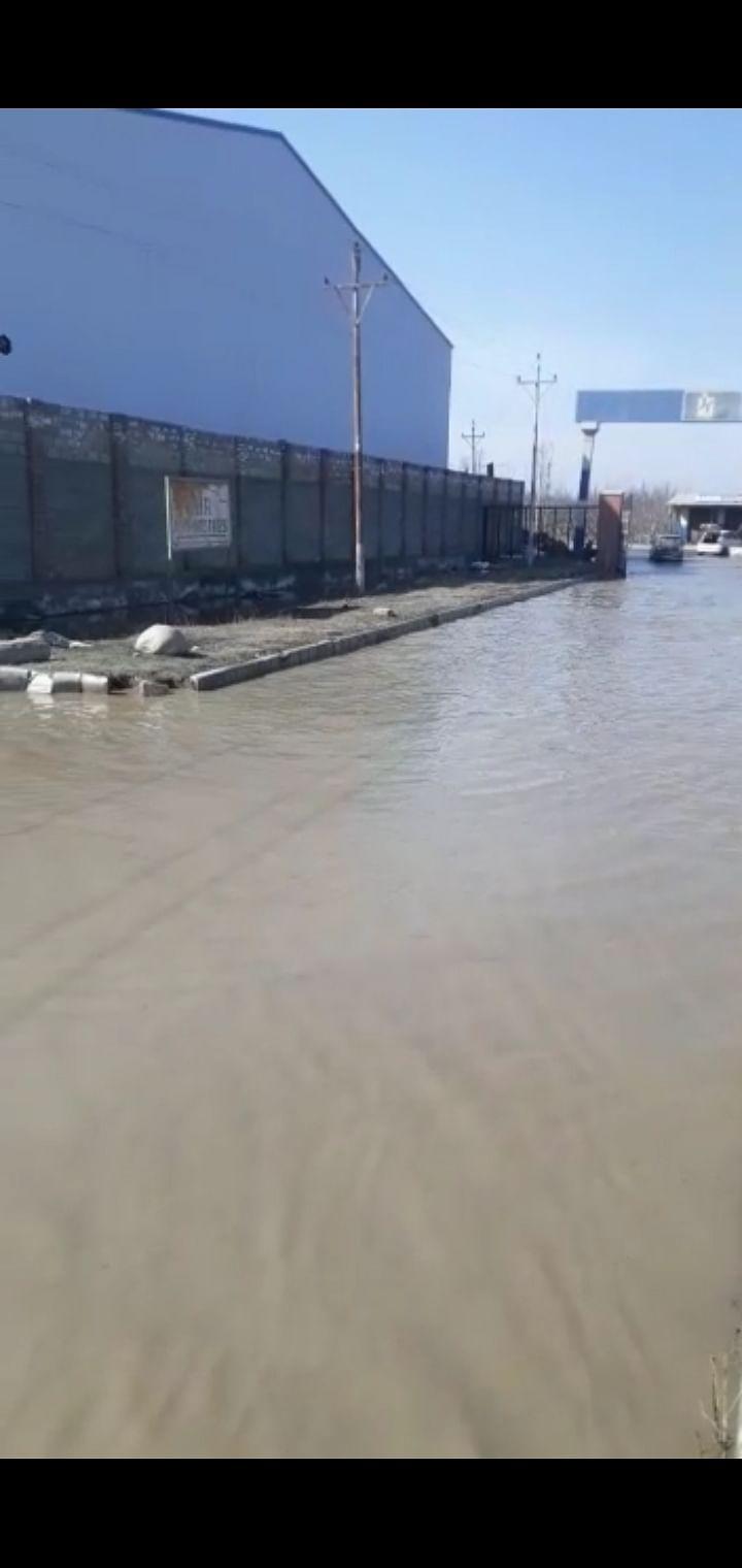 Waterlogged road at Lassipora IE irk industrialists