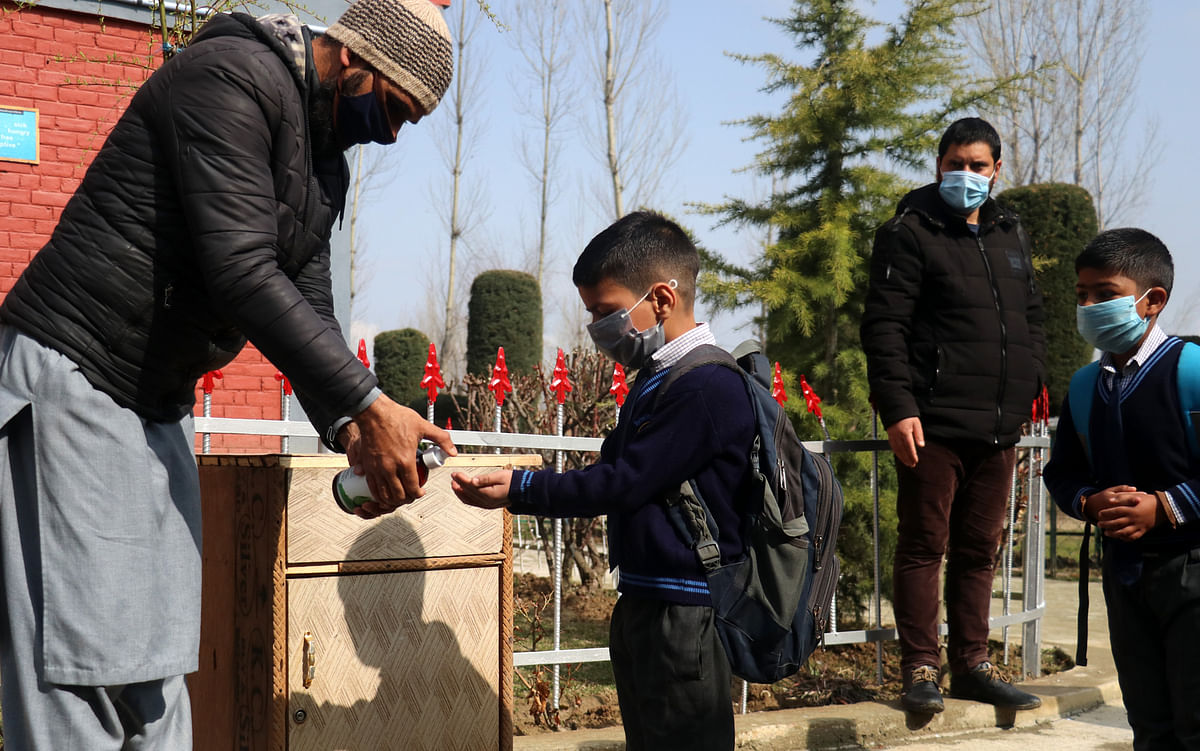 Students of primary classes make way to schools in Kashmir first time after COVID-19 lockdown
