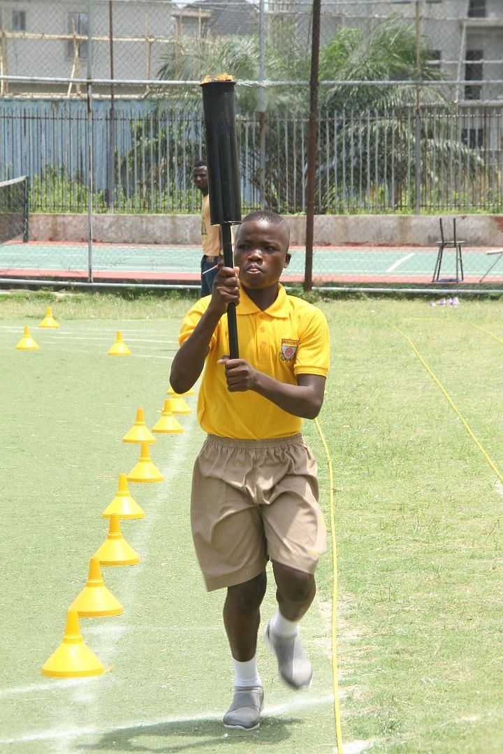 School Prefect carrying the flame at Artville School Inter-house Sports