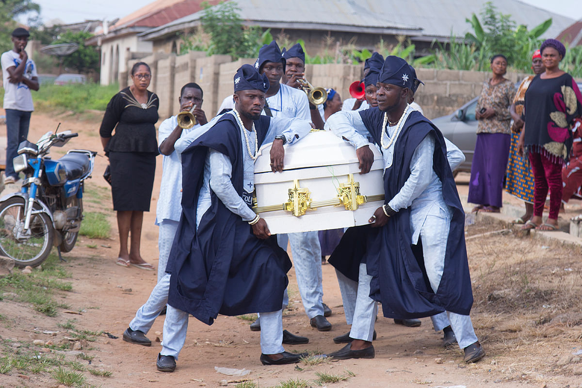 The pall bearers carrying mama's corpse